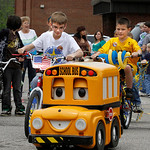Follow the little Yellow School bus. Following behind the bus are Jaret Tiller (in white T-Shirt) and his brother Luke tiller in the Yellow T-shirt.  Photo by Tom Mahl
