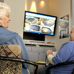 In this Tuesday, Oct. 5, 2010 photo, volunteers Betty Wuest, left, of Westwood, Ohio, and Janet Morgan of Dent, Ohio, watch Nikki the pregnant Indian rhinoceros via video monitors at the Cin …