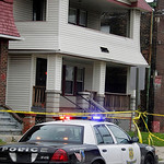 A Cleveland police cruiser sits in front of the home of Anthony Sowells Wednesday, Nov. 4, 2009, in Cleveland. Sowell, 50, has been charged with five counts of aggravated murder and held wit …