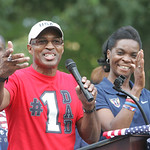 Tianna's dad, Bob, speaks at the rally surrounded on stage by family and wife Jo Ann, right. Elyria fans and family of Tianna Madison turn out at Ely Square to cheer on hometown track and fi …