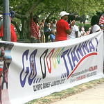 Elyria fans and family of Tianna Madison — including proud dad Robert Madison, in red with white hat behind the sign — turn out at Ely Square to cheer on hometown track and field star wh …
