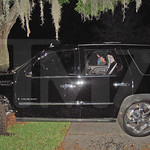 This photo taken Nov. 27, 2009 and provided by the celebrity Web site TMZ.com shows a Cadillac Escalade that Tiger Woods crashed into a tree outside his home in Windermere, Fla. (AP Photo/TM …