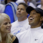 FILE – In this June 11, 2009 file photo, Elin Nordegren talks to her husband, golfer Tiger Woods during the first quarter of Game 4 of the NBA basketball finals in Orlando, Fla. Tiger Woods  …