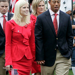 FILE – In this Oct. 7, 2009 file photo, United States team player Tiger Woods, right, is joined by wife, Elin Nordegren, at opening ceremonies for the Presidents Cup golf matches in San Fran …