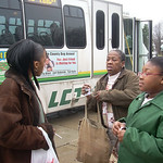 Charlissa Martin, 39, left, talks with Brenda Milton and daughter Treasure, 9, all of Elyria, about the county's plan to elimate all fixed bus routes.  Cindy Leise photo