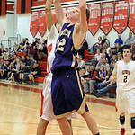 Vermilion Forrest Boyd has ball knocked away by Elyria Jarred Schultz in first half Jan. 29.  Steve Manheim