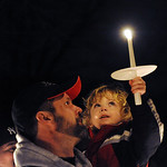 Richard Clifford, Alexandra's father,  with Jayden, Allie's nephew, at a vigil on Feb. 28.   Stev eManhiem