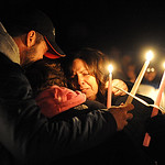 Richard Clifford, left, father of Alexandra Clifford, with sister Nicollette, and mother Angela, at a candleight vigil for Alexandra at East Recreation Park on Prospect St. on Feb. 28.  Seve …