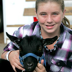 MaKayla McKenzie, 12, of LaGrange, Ohio holds Tazz, a male pygmy goat that she was going to show on Wednesday. photo by Chuck Humel