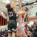 Elyria Kody Bender shoots over Westlake Connor Meek Jan. 8.  Steve Manheim