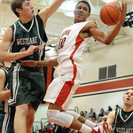 Elyria's Isaiah Walton goes up for rebound against Westlake's Gavin Skelly in first half Jan. 8.  Steve Manheim