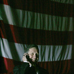 29JAN12 Country singer Willie Nelson arrived in Lorain to play a fundraiser concert for Dennis Kucinich. Dennis Kucinich takes a call backstage waiting for Willie Nelson's tour bus to arr …