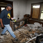 Calvin Brooks, a member of Black on Black Crime, a community group which holds rallies and is heavily involved in neighborhoods, searches a home Sunday, July 21, 2013, in East Cleveland, Ohi …