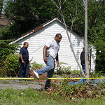 East Cleveland police search Sunday, July 21, 2013, near where three bodies were recently found, in East Cleveland, Ohio. The bodies, believed to be female, were found about 100 to 200 yards …