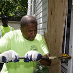 City of East Cleveland service department employee Ray Allen breaks into an abandoned house so searchers can enter Sunday, July 21, 2013, in East Cleveland, Ohio. Police Chief Ralph Spotts t …
