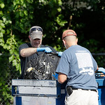 Investigators take out a black trash bag from a dumpster Sunday, July 21, 2013 near where three bodies were recently found in East Cleveland, Ohio. Searchers rummaging through vacant houses  …