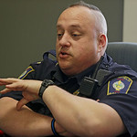 This Tuesday, April 2, 2013 photo shows Brimfield Police Chief David Oliver, in Kent, Ohio. Oliver uses the reach of his department's increasingly followed Facebook page to interact with r …
