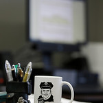 This Tuesday, April 2, 2013 photo shows Brimfield Police Chief David Oliver's coffee cup resting on his desk in Kent, Ohio. Oliver uses the reach of his department's increasingly followed …