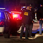 Police hold a man in handcuffs, who they later released, in a neighborhood of Watertown, Mass., Friday, April 19, 2013.  Much of the town is blocked as police and federal officers hunt for s …