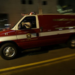 An ambulances drives into Massachusetts Institute of Technology following reports of a shooting, Friday, April 19, 2013, in Boston. State police say a campus police officer at the school has …