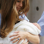 Kate, Duchess of Cambridge holds the Prince of Cambridge, Tuesday July 23, 2013, as they pose for photographers outside St. Mary's Hospital exclusive Lindo Wing in London where the Duchess g …
