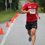Michal Orzel of Oberlin, OH at the finish wins 3rd place overall in the Columbia Station half marathon run and skate. photo by Ray Riede