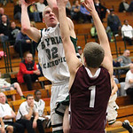 EC's John Stursa (32) shoots over Rocky River's Ryan McCrone (1). photo by Ray Riedel
