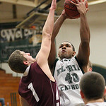 EC&#039;s Xavier Bennett is fouled while shooting by Ryan McCrone of Rocky River. photo by Ray Riedel