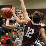 EC&#039;s Connor Riddell shoots and is fouled by Alec Hallal (12) of Rocky River.  photo by Ray Riedel