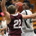 EC&#039;s D.J. Graham looks to pass while covered by Rocky River&#039;s Eric Jones (22). photo by Ray Riedel