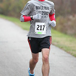 Ryan McCartney, 2003 graduate of Admiral King High School, is third in the 13.1 mile Inland Trail half marathon. Photo by Ray Riedel
