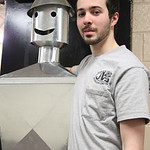 Alexander Ladina of Oberlin poses with the HVAC tinman he built for the Lorain County Joint Vocational School open house in Oberlin. Alexander won a gold medal in Ohio for his skills and qua …