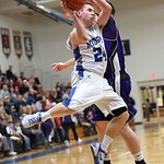 Midview&#039;s Grant Overy flies to the basket against Keystone. photo by Ray Riedel