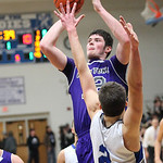 Keystone&#039;s Chase Robison shoots over Midview&#039;s Wes Davic. photo by Ray Riedel