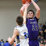 Keystone&#039;s Chase Robison shoots over Midview&#039;s Tyler Pasenow.  photo by Ray Riedel