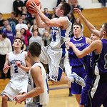 Midview&#039;s Grant Overy does a Michael Jordan move in the paint against Keystone. photo by Ray Riedel