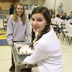 Jamie Krantz (foreground) and Brandi Taylor clear tables at the St. mary&#039;s free Thanksgiving meal. photo by Ray Riedel
