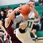 Columbia's Jacob Simon struggles for the rebound against Wellington's Dave Clark. photo by Ray Riedel