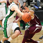 Columbia's Zach Stopper steals the ball, but fouls Wellington's Dave Clark  in the process. photo by Ray Riedel
