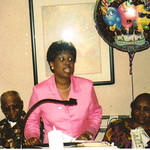 Sylvester Cooper, left, and his wife, Bertha, right, listen as their daughter Connie Young speaks at Bertha's 80th birthday party in Tennessee in 2005.
