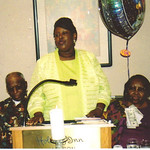 Sylvester Cooper, left, and his wife, Bertha Cooper, right, listen to their daughter Barbara Cooper speak at Bertha's 80th birthday party in 2005.