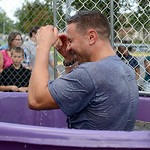 Washington Elementary School principal John Monteleone is knocked into the water by his students at the back to school open house on Aug. 20.  KRISTIN BAUER | CHRONICLE