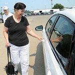 Nancy Mathewson, of Doylestown, formerly of Elyria, picks up the 2014 Ford Fusion she won with a ticket in the St. Jude Dream Home giveaway event at Nick Abraham Ford in Elyria on Aug. 7. ST …