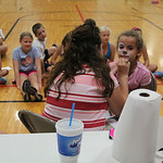 Alyce Williams, 9, of Elyria gets her face painted at East Recreational Center during a kid's day camp activity on Aug. 6.  ALEC SMITH | CHRONICLE