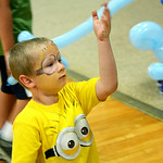 Anthony Reitz, 6, of Elyria, plays with his newly made balloon animal after having his face painted during a Reach and Rise Discovery Camp activity at East Recreation Center on Aug. 6.  KRIS …