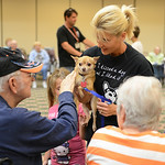 Aurther Novalese reaches out to pet Clyde, who is held by Friendship APL volunteer Donna Biggar, of Avon Lake, on Aug. 15. KRISTIN BAUER | CHRONICLE