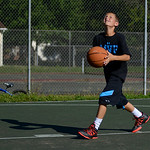 Brennen Cole, 11, of LaGrange, practices making shots at the basketball courts on the corner of West Street and West Prospect Street. KRISTIN BAUER | CHRONICLE