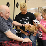 David Kauf reaches out to pet Clyde, held by Friendship APL volunteer Donna Biggar, of Avon Lake, alongside of Adelynn Biggar, 4, and Olivia Magnoli, 5, on Aug. 15 during Wesleyan Village's  …