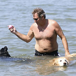 Larry Rudy plays with his lab, Jack, and his golden retriever, Joe Dirt, at Main Street Beach in Vermilion. BRUCE BISHOP/CHRONICLE