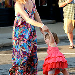 Jina Saunders and her daughter Ellie, 2, both of Bay Village, dance on Park Avenue in Amherst during the annual dancing downtown event on Aug. 2.   KRISTIN BAUER | CHRONICLE